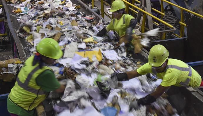 ELKRIDGE, MD - JUNE 18: Workers are seen sorting as the conveyo